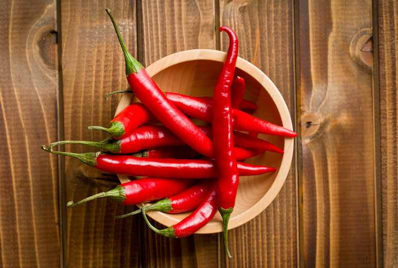 bigstock-top-view-of-chili-peppers-in-b-51670738