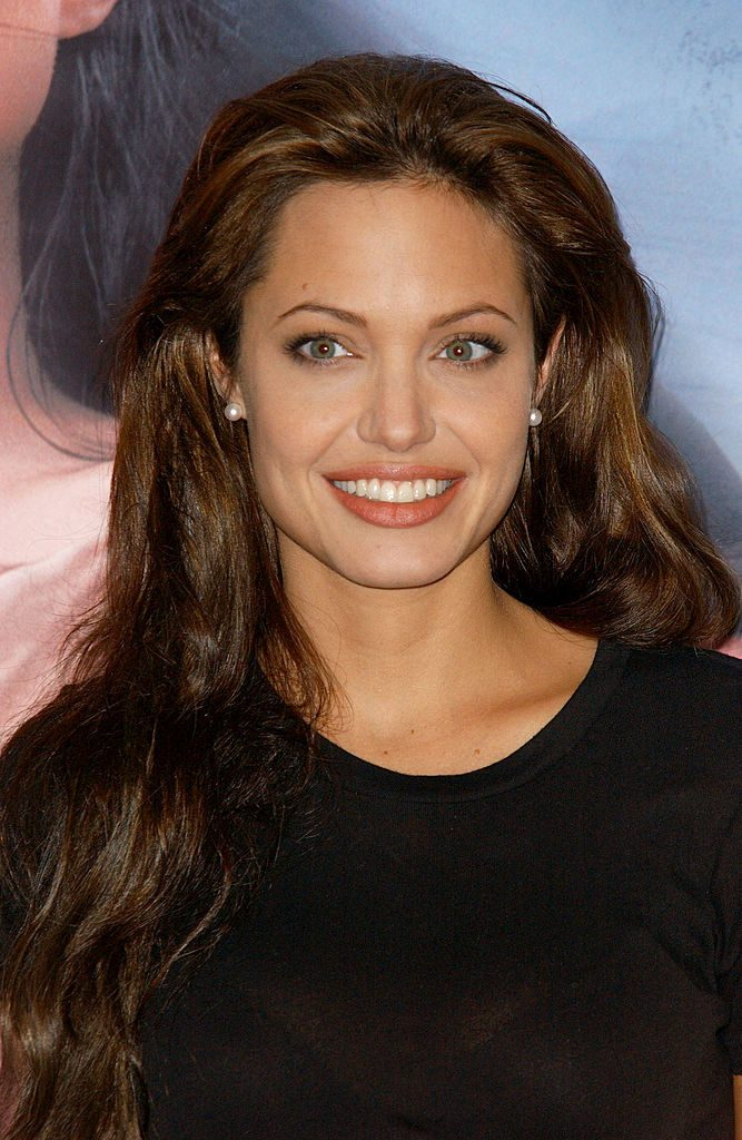 "MADRID, SPAIN - OCTOBER 15: Actress Angelina Jolie attends a promotional photocall for her new movie ""Beyond Borders"" October 15, 2003 at Hotel Palace in Madrid, Spain. (Photo by Carlos Alvarez/Getty Images)"