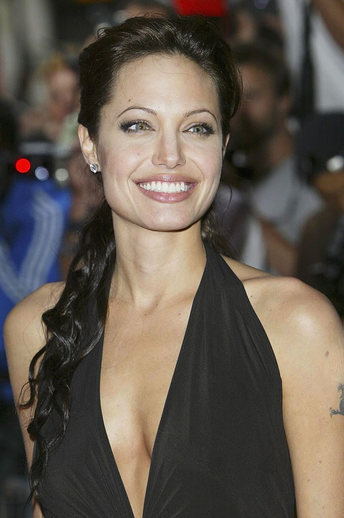 "LONDON - AUGUST 19: Actress Angelina Jolie arrives at the premiere of ""Lara Croft Tomb Raider: The Cradle Of Life"" at the Empire Cinema Leicester Square on August 19, 2003 in London. (Photo by Steve Finn/Getty Images)"