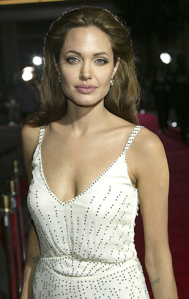 "HOLLYWOOD - SEPTEMBER 14: Actress Angelina Jolie attends the world premiere of ""Sky Captain And The World of Tomorrow"" at the Grauman's Chinese Theatre on September 14, 2004 in Hollywood, California. (Photo by Frederick M. Brown/Getty Images)"