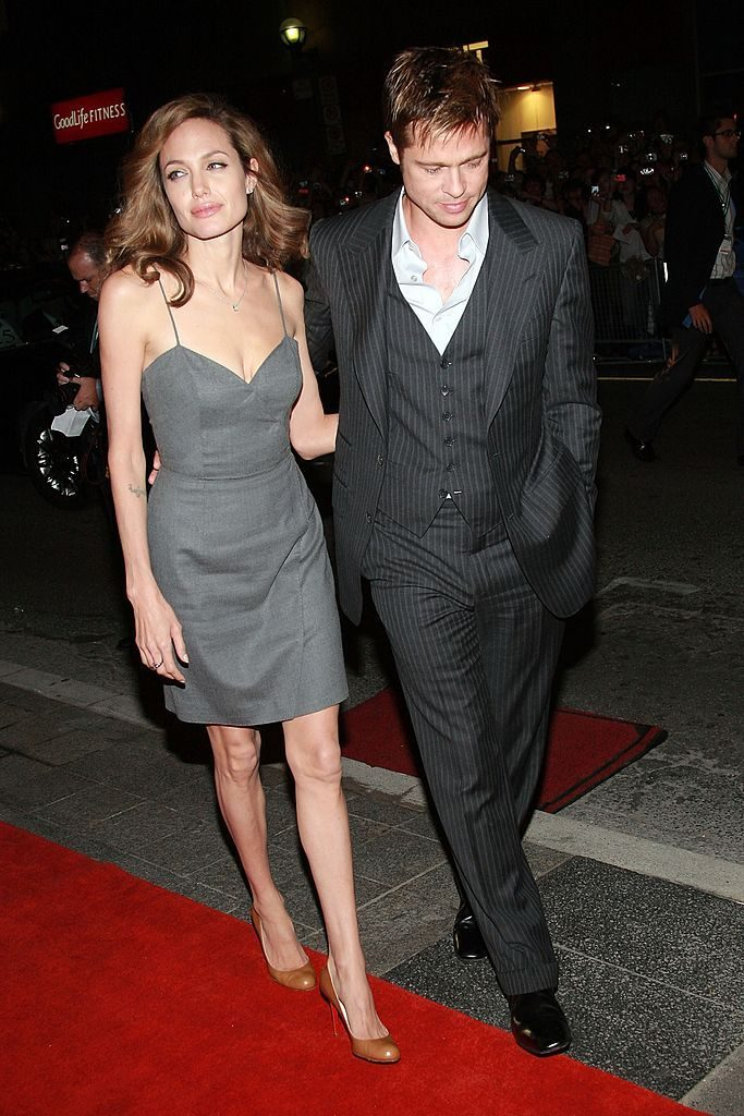 "TORONTO, ON - SEPTEMBER 08: Actress Angelina Jolie and actor Brad Pitt arrive at the ""The Assassination of Jesse James by the Coward Robert Ford"" North American Premiere screening during the Toronto International Film Festival 2007 held at the Elgin Theatre on September 8, 2007 in Toronto, Canada. (Photo by Evan Agostini/Getty Images)"