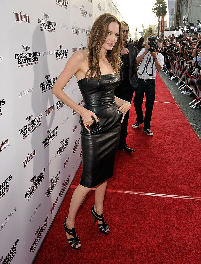"HOLLYWOOD - AUGUST 10: Actress Angelina Jolie arrives at the premiere of Weinstein Co.'s ""Inglourious Basterds"" held at Grauman's Chinese Theatre on August 10, 2009 in Hollywood, California. (Photo by Kevin Winter/Getty Images)"