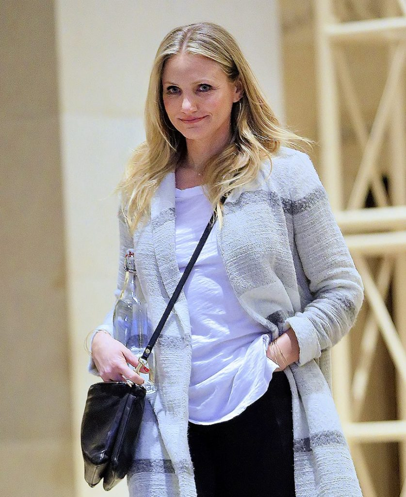 Cameron Diaz carries a big water bottle when walking inside an office building with a smile in New York City, NY  Pictured: Cameron Diaz