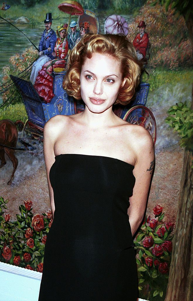 Angelina Jolie poses for photographers upon her arrival at the National Board of Review Awards in New York city February 8, 1999. (Photo by Diane Freed)