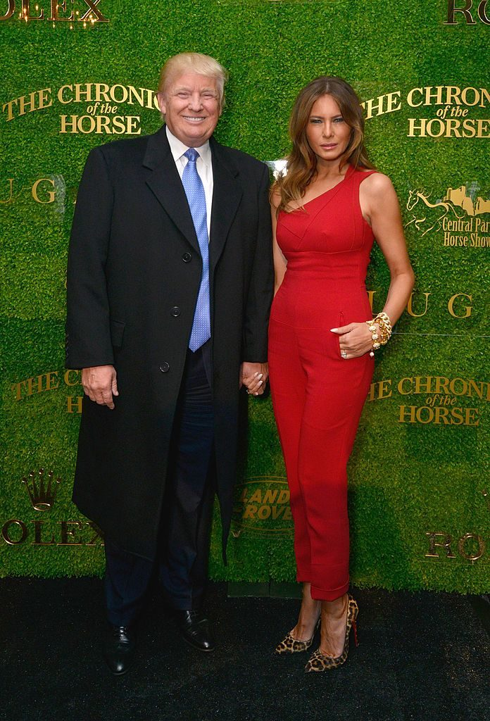 NEW YORK, NY - SEPTEMBER 18: Donald Trump (L) and Melania Trump attend Central Park Horse Show presented by Rolex and produced by Chronicle of the Horse where Land Rover was the official vehicle on September 18, 2014 in New York City. (Photo by Eugene Gologursky/Getty Images for Land Rover)